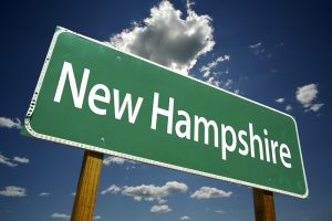 New Hampshire Road Sign with dramatic clouds and sky.